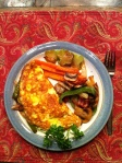 Egg crepe omelet with vegetables and cheese